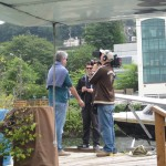 Tony talks on camera on our dock
